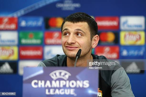 Alan Dzagoev attends a CSKA Moskva press conference ahead of their UEFA Champions League Group E match against Bayer 04 Leverkusen at BayArena on...