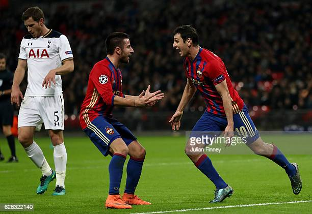 Alan Dzagoev of CSKA Moscow celebrates scoring his sides first goal with Zoran Tošic of CSKA Moscow during the UEFA Champions League Group E match...
