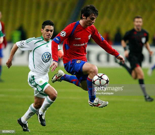 Alan Dzagoev of CSKA Moscow fights for the ball with Josue of VfL Wolfsburg during the UEFA Champions League group B match between CSKA Moscow and...