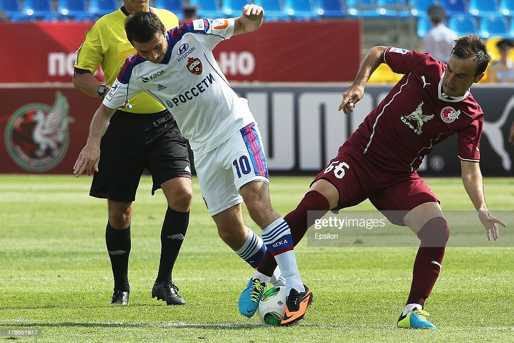 <a gi-track='captionPersonalityLinkClicked' href=/galleries/search?phrase=Alan+Dzagoev&family=editorial&specificpeople=5436464 ng-click='$event.stopPropagation()'>Alan Dzagoev</a> of FC Rubin Kazan battles for the ball with Ahmed Musa of PFC CSKA Moscow during the Russian Premier League match between PFC CSKA Moscow and FC Rubin Kazan at the Tsentralny Stadium on August 4, 2013 in Kazan, Russia.