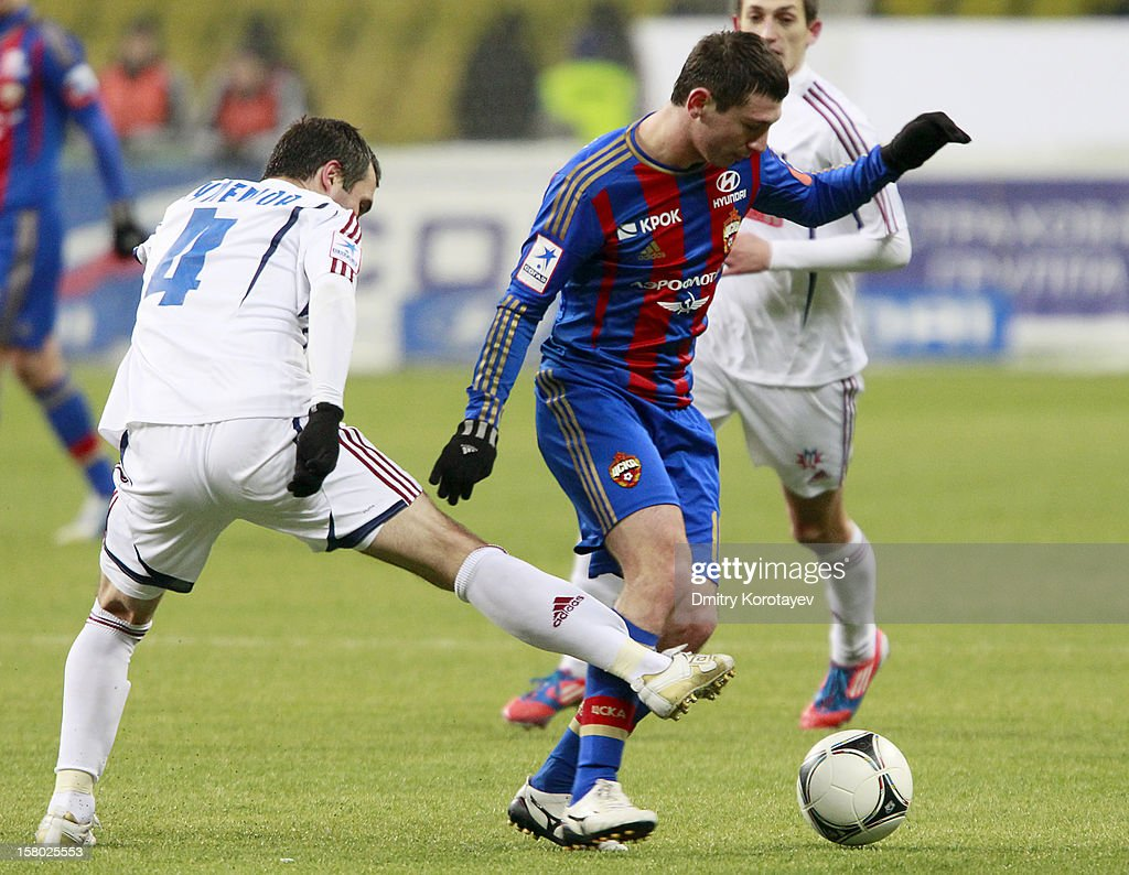 <a gi-track='captionPersonalityLinkClicked' href=/galleries/search?phrase=Alan+Dzagoev&family=editorial&specificpeople=5436464 ng-click='$event.stopPropagation()'>Alan Dzagoev</a> (R) of PFC CSKA Moscow battles for the ball with Yuri Kuleshov of FC Mordovia Saransk during the Russian Premier League match between PFC CSKA Moscow and FC Mordovia Saransk at the Luzhniki Stadium on December 09, 2012 in Moscow, Russia.