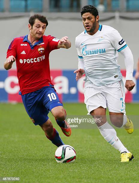 Alan Dzagoev of PFC CSKA Moscow challenged by Hulk of FC Zenit Saint Petersburg during the Russian Premier League match between PFC CSKA Moscow and...