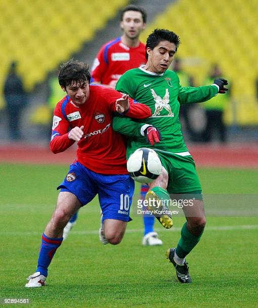 Alan Dzagoev of PFC CSKA Moscow competes for the ball with Christian Noboa of FC Rubin Kazan during the Russian Football League Championship match...