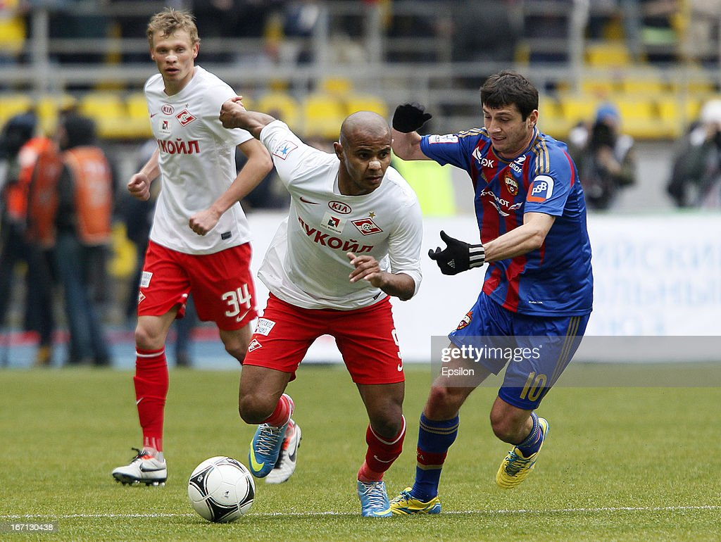 Alan Dzagoev (R) of PFC CSKA Moscow is challenged by Ari of FC Spartak Moscow during the Russian Premier League match between PFC CSKA Moscow and FC Spartak Moscow at the Luzhniki Stadium on April 21, 2013 in Moscow, Russia.