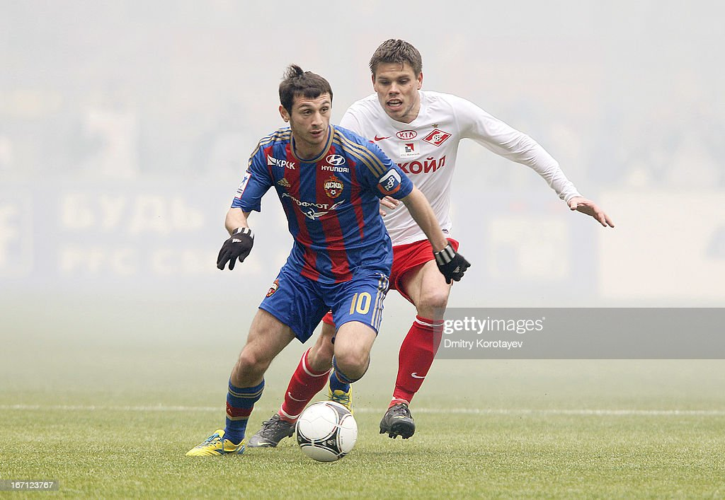 Alan Dzagoev (L) of PFC CSKA Moscow is challenged by Ognjen Vukojevic of FC Spartak Moscow during the Russian Premier League match between PFC CSKA Moscow and FC Spartak Moscow at the Luzhniki Stadium on April 21, 2013 in Moscow, Russia.