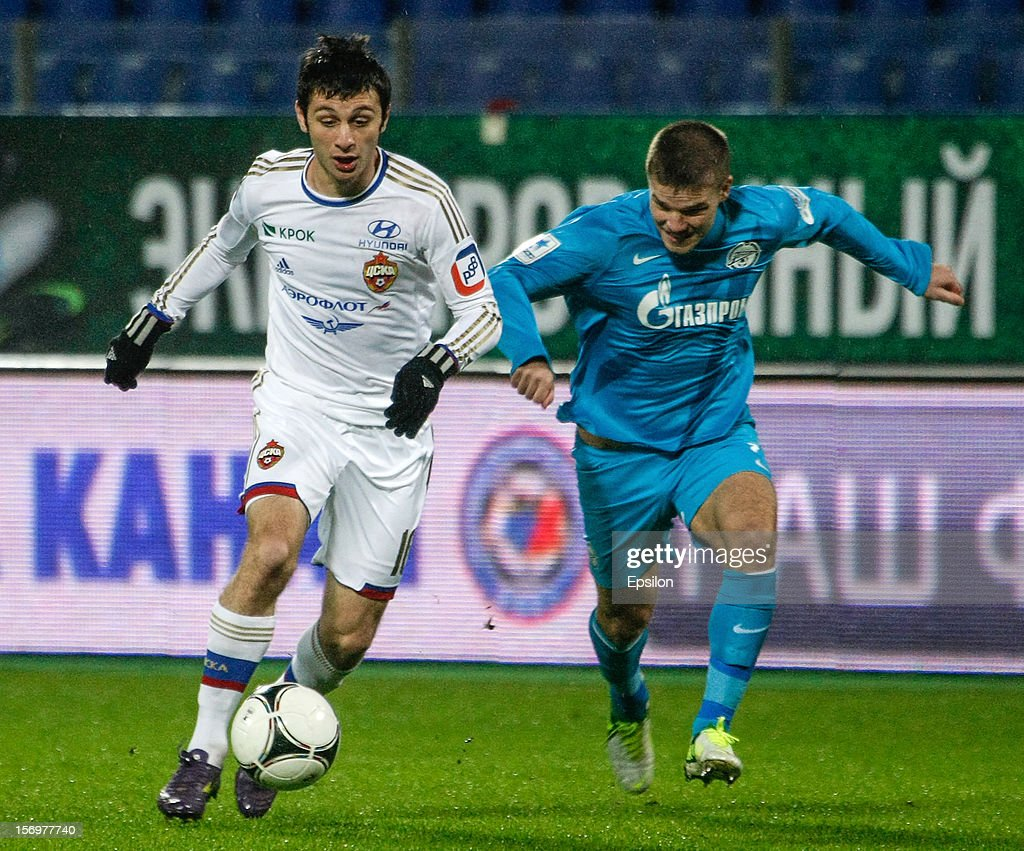 <a gi-track='captionPersonalityLinkClicked' href=/galleries/search?phrase=Alan+Dzagoev&family=editorial&specificpeople=5436464 ng-click='$event.stopPropagation()'>Alan Dzagoev</a> of PFC CSKA Moscow (L) vies for the ball with <a gi-track='captionPersonalityLinkClicked' href=/galleries/search?phrase=Igor+Denisov&family=editorial&specificpeople=648334 ng-click='$event.stopPropagation()'>Igor Denisov</a> of FC Zenit St. Petersburg during the Russian Football League Championship match between FC Zenit St. Petersburg and PFC CSKA Moscow at the Petrovsky Stadium on November 26, 2012 in St. Petersburg, Russia.