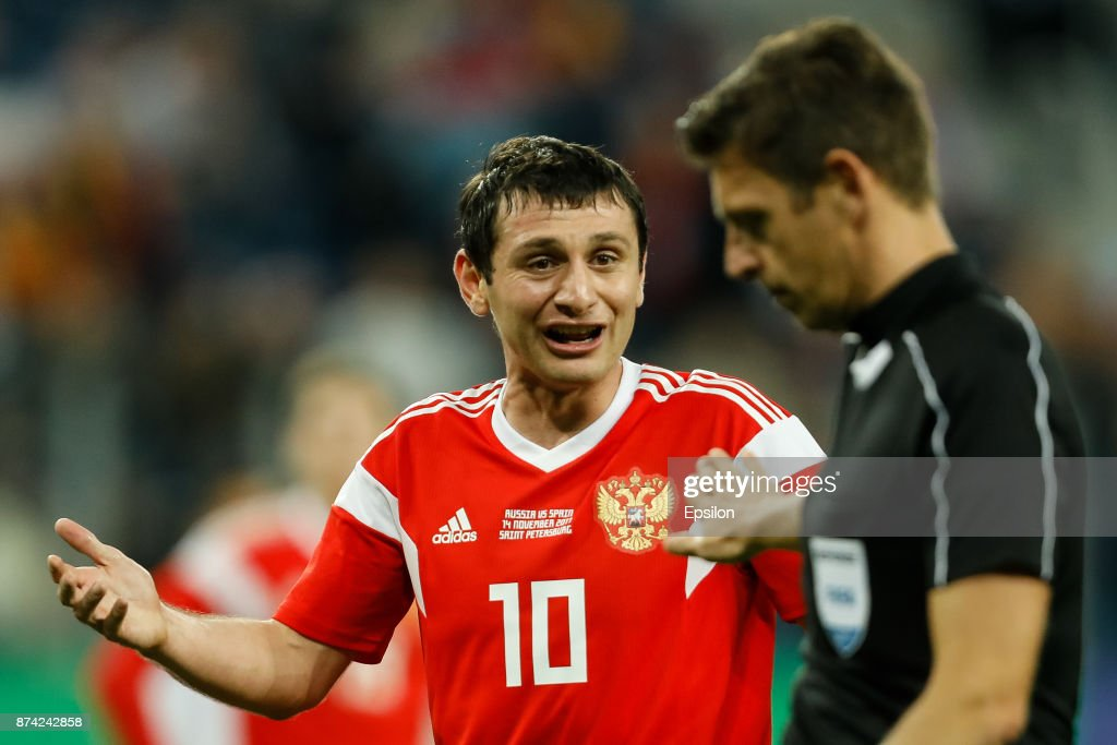 Alan Dzagoev (L) of Russia argues with the referee Gianluca Rocchi during Russia and Spain International friendly match on November 14, 2017 at Saint Petersburg Stadium in Saint Petersburg, Russia.