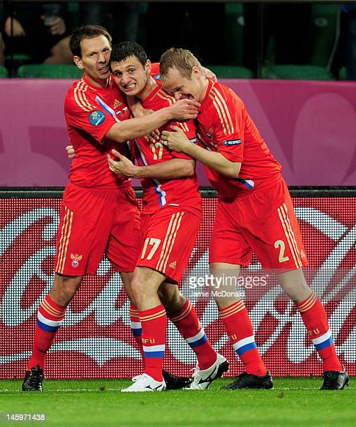 Alan Dzagoev of Russia celebrates scoring their opening goal with team mates during the UEFA EURO 2012 group A match between Russia and Czech...