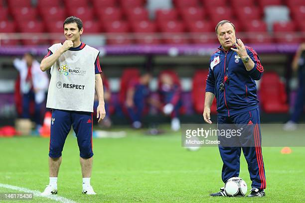 Alan Dzagoev of Russia looks on alongside coach Dick Advocaat during a UEFA EURO 2012 training session at the National Stadium on June 11 2012 in...