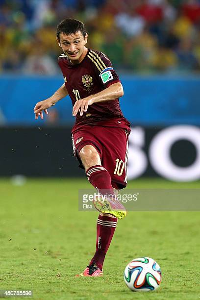 Alan Dzagoev of Russia passes the ball during the 2014 FIFA World Cup Brazil Group H match between Russia and South Korea at Arena Pantanal on June...