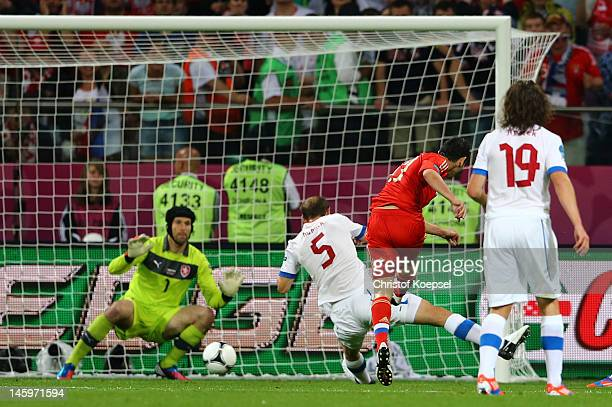 Alan Dzagoev of Russia scores their opening goal past Petr Cech of Czech Republic during the UEFA EURO 2012 group A match between Russia and Czech...