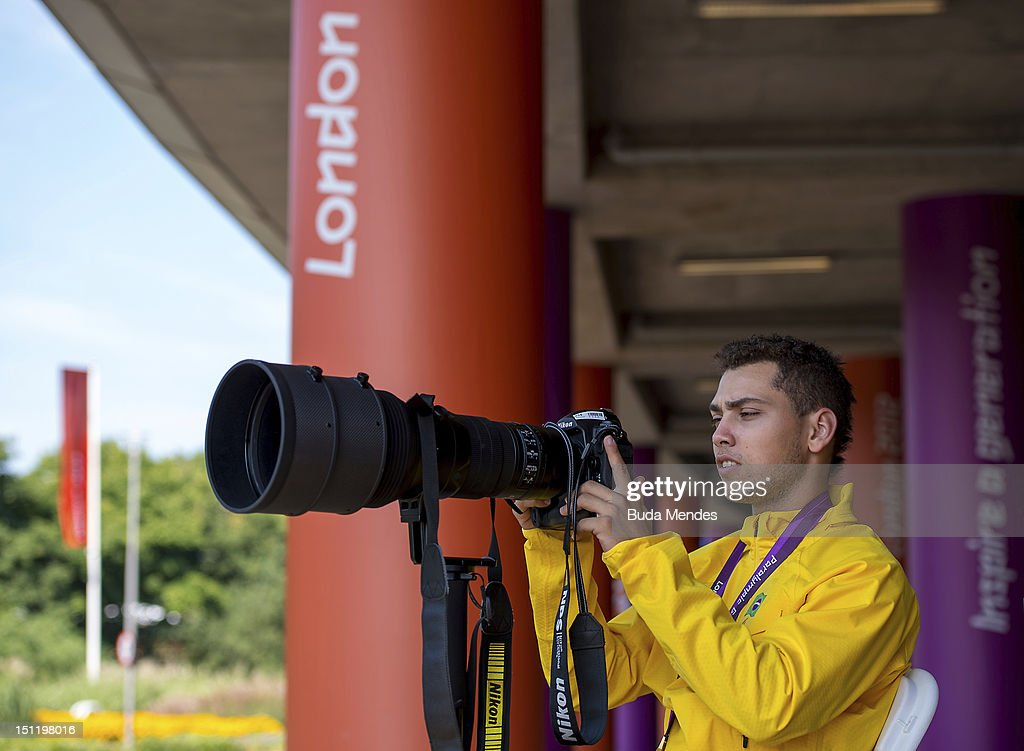 Alan Fonteles Cardoso Oliveira from Brazil tests the photographer's equipment after receiving the gold medal at the London 2012 Paralympic Games at the Olympic Stadium on September 03, 2012 in London, England.