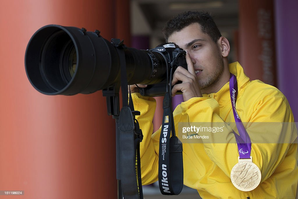 Alan Fonteles Cardoso Oliveira from Brazil tests the photographer's equipment after receiving the gold medal at the London 2012 Paralympic Games at...