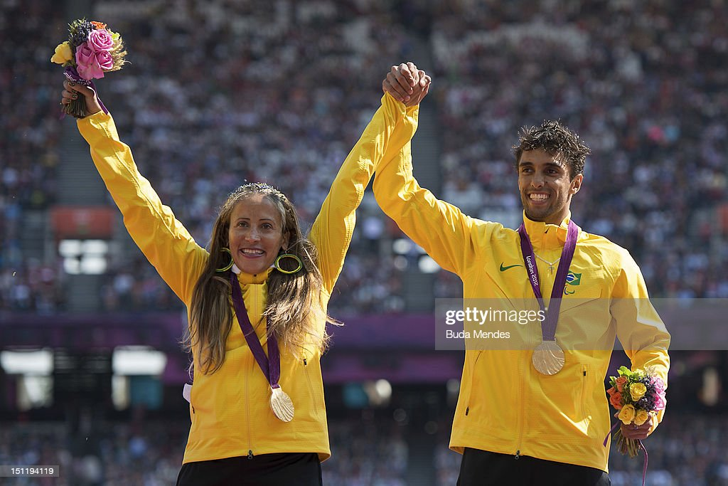 Alan Fonteles Cardoso Oliveira of Brazil celebrates a gold medal in the Men's 200m T44 with Terezinha Guilhermina also from Brazil who won gold in...