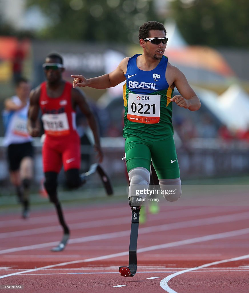 Alan Fonteles Oliveira of Brazil crosses the line to win the Men's 200m T43 final during day two of the IPC Athletics World Championships on July 21...