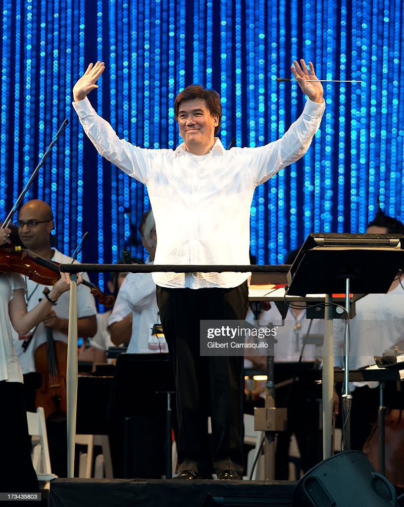 Alan Gilbert, Music Director of the New York Philharmonic performs during 2013 Major League Baseball All-Star Charity Concert starring The New York Philharmonic with Special Guest Mariah Carey Benefiting Sandy Relief at Central Park, Great Lawn on July 13, 2013 in New York City.