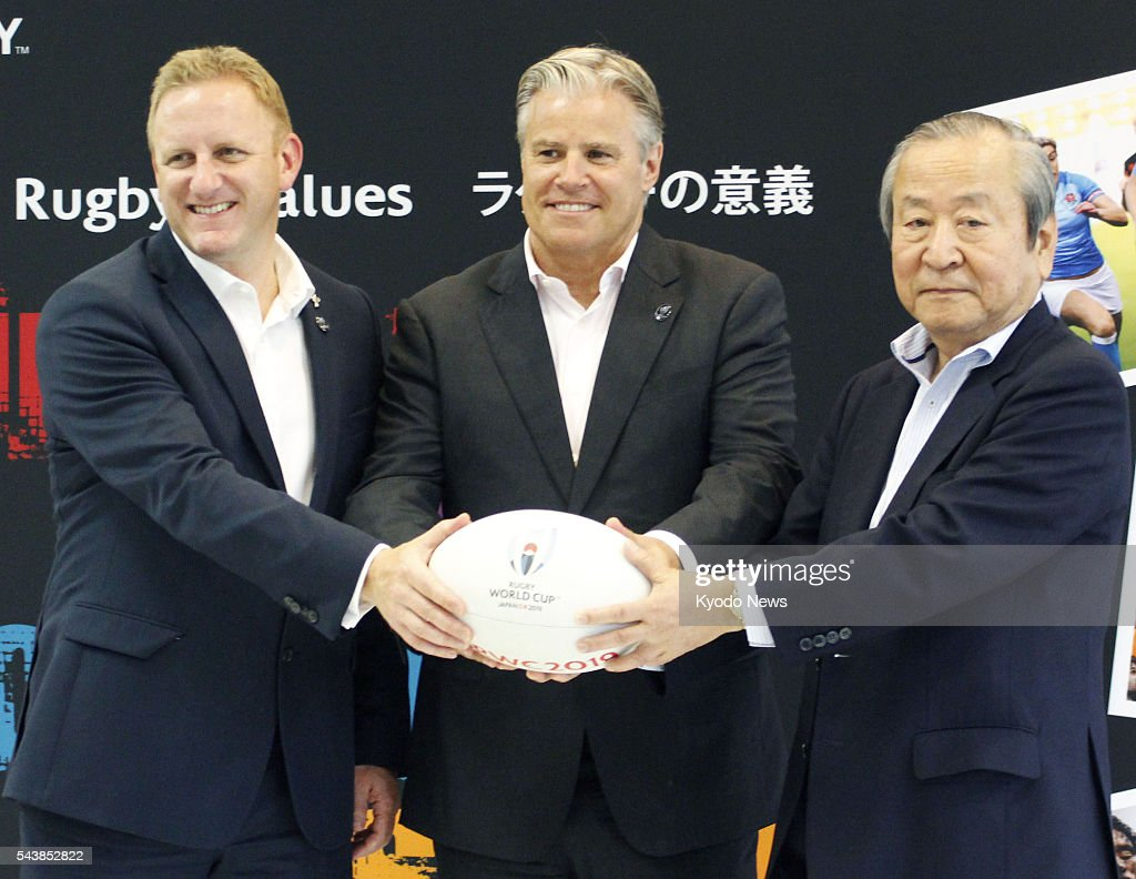 Alan Gilpin, head of Rugby World Cup, World Rugby Chief Executive Brett Gosper and Japan Rugby 2019 Chief Executive Akira Shimazu pose for a photo in Tokyo on June 30, 2016. The organizing committee for the 2019 World Cup in Japan announced the same day that its draw will be hosted in the western Japan city of Kyoto in May next year.