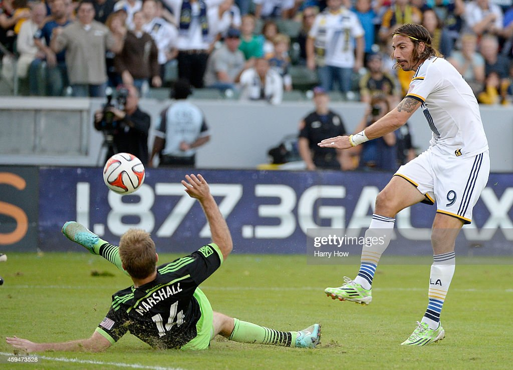 Alan Gordon #9 of Los Angeles Galaxy has his shot blocked by Chad Marshall #14 of Seattle Sounders FC during a 2-1 Galaxy win in the Western Conference Final at StubHub Center on November 23, 2014 in Los Angeles, California.