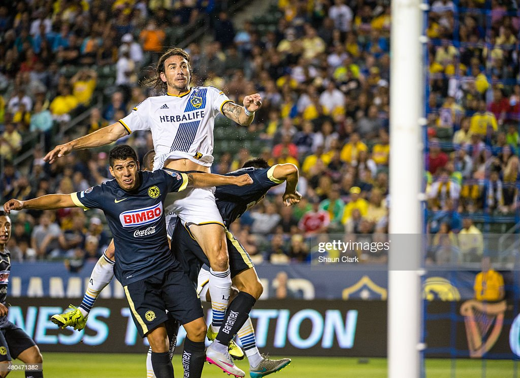 <a gi-track='captionPersonalityLinkClicked' href=/galleries/search?phrase=Alan+Gordon+-+Soccer+Player&family=editorial&specificpeople=11667134 ng-click='$event.stopPropagation()'>Alan Gordon</a> #9 of Los Angeles Galaxy out jumps Paolo Goltz #2 of Club America to score the game winning goal during the International Champions Cup 2015 match between Club America and Los Angeles Galaxy at the StubHub Center on July 11, 2015 in Carson, California.