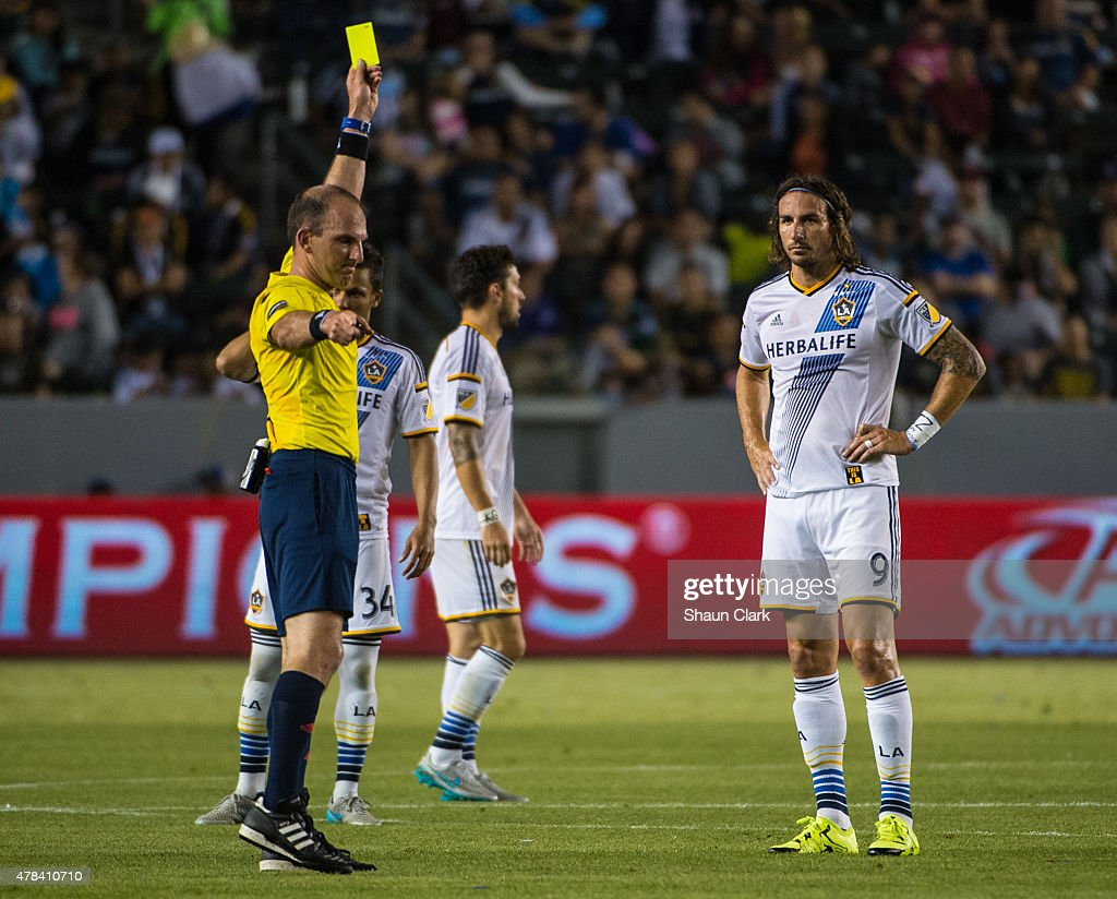Alan Gordon (9) of Los Angeles Galaxy receives a yellow card from Referee Ted Unkel for a foul on Liam Ridgewell (24) of Portland Timbers during Los Angeles Galaxy's MLS match against Portland Timbers at the StubHub Center on June 24, 2015 in Carson, California. The LA Galaxy won the match
