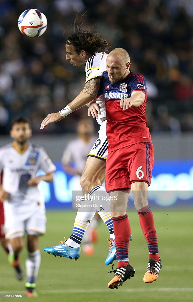 Alan Gordon #9 of the Los Angeles Galaxy and Eric Gehrig #6 of the Chicago Fire jump for the ball at StubHub Center on March 6, 2015 in Los Angeles, California. The Galaxy won 2-0.
