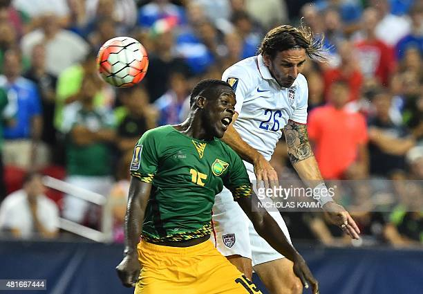 Alan Gordon of the US vies with Jamaica's JeVaughn Watson during a CONCACAF Gold Cup semifinal football match in Atlanta on July 22 2015 AFP...