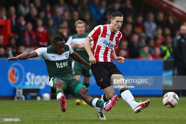 Alan Gow of Exeter City is challenged by Onismor Bhasera of Plymouth Argyle during the npower League Two match between Exeter City and Plymouth...