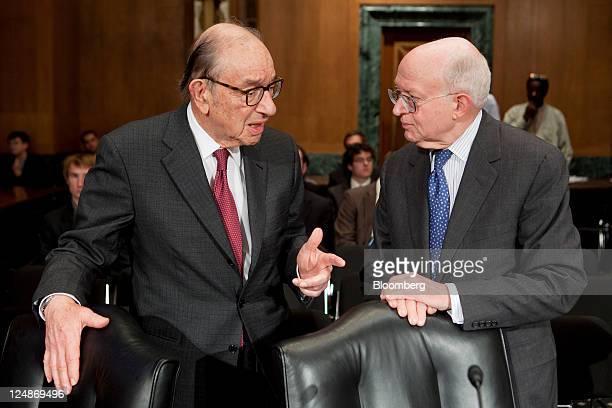 Alan Greenspan former chairman of the US Federal Reserve left talks to Martin Feldstein professor of economics at Harvard University before a Senate...