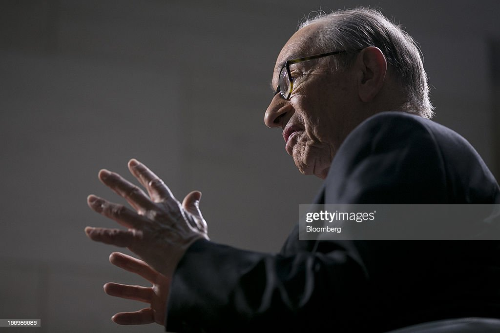 Alan Greenspan, former Federal Reserve chairman and president and founder of Greenspan Associates, speaks during a Bloomberg Television interview at the International Monetary Fund (IMF) and World Bank Group Spring Meetings in Washington, D.C., U.S., on Friday, April 19, 2013. A U.S. budget agreement that includes debt reduction needs to be reached to revive economic growth, Greenspan said. Photographer: Andrew Harrer/Bloomberg via Getty Images