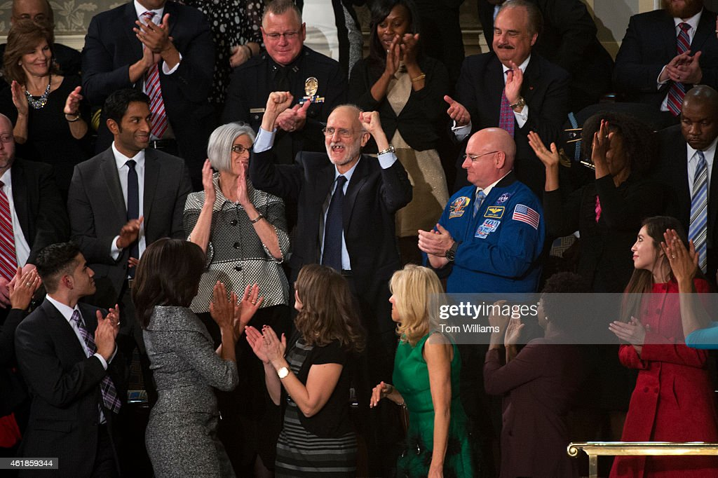 <a gi-track='captionPersonalityLinkClicked' href=/galleries/search?phrase=Alan+Gross&family=editorial&specificpeople=6994459 ng-click='$event.stopPropagation()'>Alan Gross</a>, a guest of the First Lady <a gi-track='captionPersonalityLinkClicked' href=/galleries/search?phrase=Michelle+Obama&family=editorial&specificpeople=2528864 ng-click='$event.stopPropagation()'>Michelle Obama</a>, lower left, is recognized in the Capitol's House chamber during President Barack Obama's State of the Union address, January 20, 2015. Gross was imprisoned in Cuba for five years.