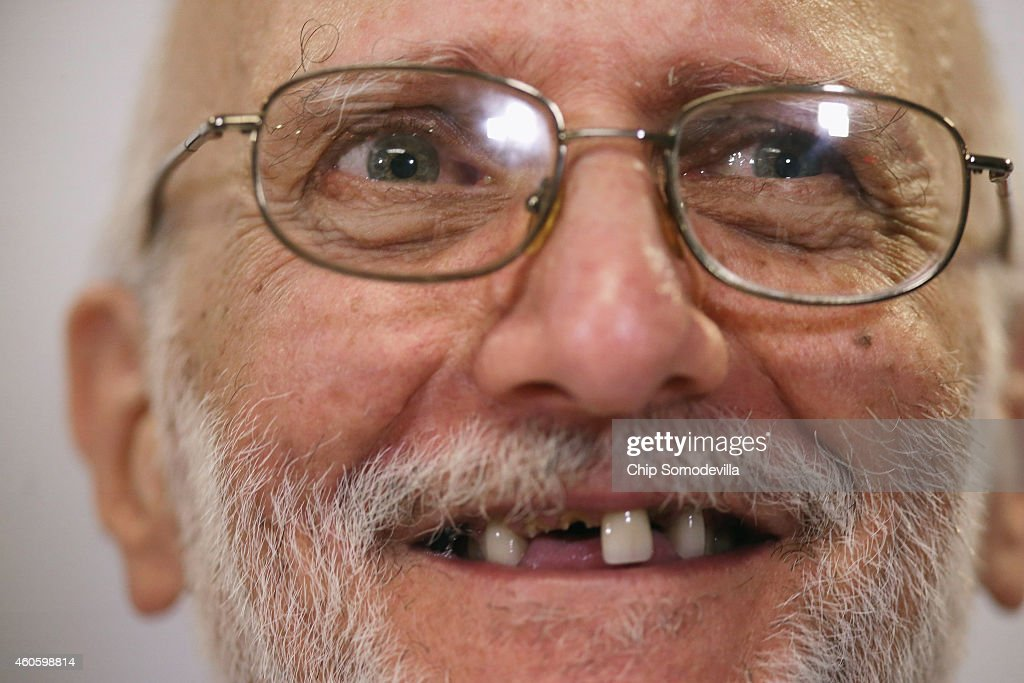 Alan Gross makes a statement to the news media at the law offices of Gilbert LLC after he arriving back in the United States December 17, 2014 in Washington, DC. A United States Agency for International Develpment contractor, Gross was imprisoned in Cuba for five years on espionage charges after he delivered satellite telephone equipment to Jews living on the island. Gross' release is signalling a new era in U.S.-Cuba relations as President Barack Obama announced a political thawing between the two countries, the first in more than 50 years.
