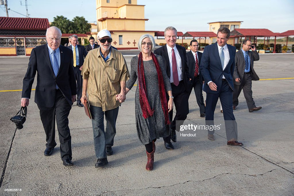Alan Gross on the tarmac with his wife, Judy Gross, attorney Scott Gilbert, Sen. Jeff Flake, (R-AZ), Sen. Patrick Leahy, (D-VT) and Rep. Chris Van Hollen, (D-MD) during his release December 17, 2014 at an airport near Havana, Cuba.. Obama announced plans to restore diplomatic relations with Cuba, over 50 years after they were severed in January 1961. In a prisoner exchange, U.S. contractor Alan Gross was freed after being held in Cuba since 2009 and sent to Cuba three Cuban spies who had imprisoned in the U.S. since 2001.