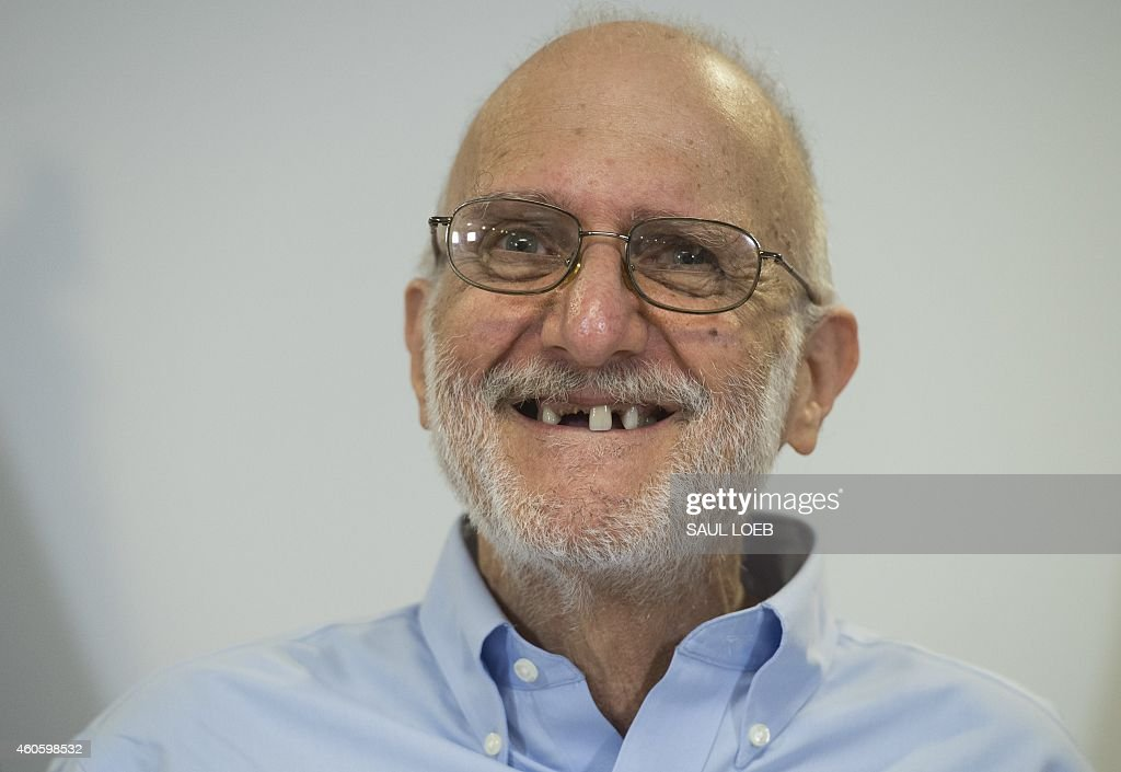 <a gi-track='captionPersonalityLinkClicked' href=/galleries/search?phrase=Alan+Gross&family=editorial&specificpeople=6994459 ng-click='$event.stopPropagation()'>Alan Gross</a> smiles during a press conference after being released by Cuba on December 17, 2014 in Washington,DC. Gross, an American contractor jailed on the communist-ruled island since 2009, was released amid signs of an imminent thaw in ties between the Cold War foes. AFP PHOTO / SAUL LOEB