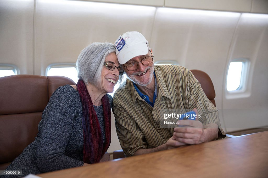<a gi-track='captionPersonalityLinkClicked' href=/galleries/search?phrase=Alan+Gross&family=editorial&specificpeople=6994459 ng-click='$event.stopPropagation()'>Alan Gross</a> takes a selfie with his wife, Judy Gross, onboard a government plane headed back to the U.S., December 17, 2014. Obama announced plans to restore diplomatic relations with Cuba, over 50 years after they were severed in January 1961. In a prisoner exchange, U.S. contractor <a gi-track='captionPersonalityLinkClicked' href=/galleries/search?phrase=Alan+Gross&family=editorial&specificpeople=6994459 ng-click='$event.stopPropagation()'>Alan Gross</a> was freed after being held in Cuba since 2009 and sent to Cuba three Cuban spies who had imprisoned in the U.S. since 2001.