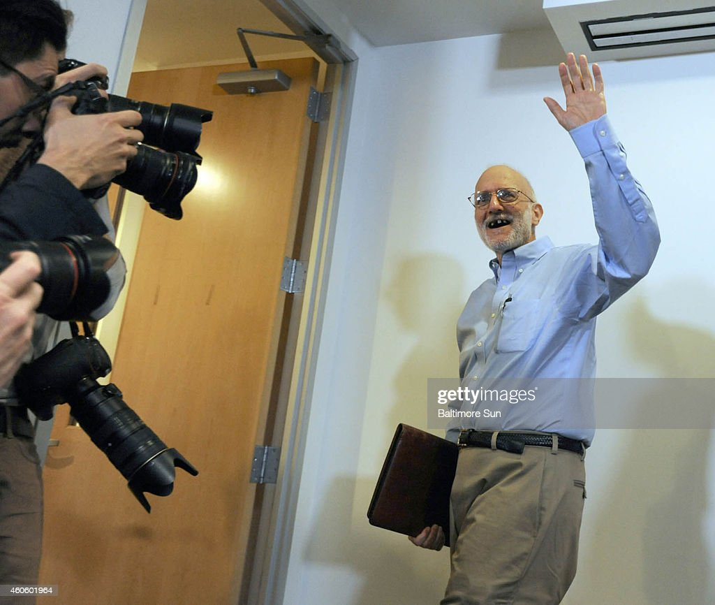 Alan Gross waves to the press after speaking at Gilbert LLP law firm following his release from a Cuban prison on Wednesday, Dec. 17, 2014.
