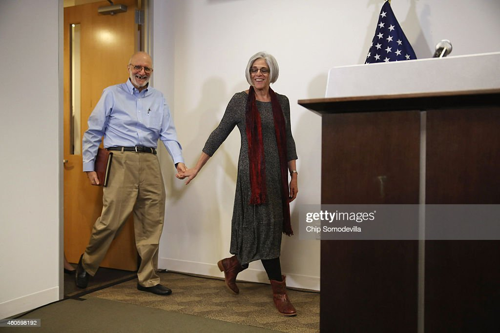 <a gi-track='captionPersonalityLinkClicked' href=/galleries/search?phrase=Alan+Gross&family=editorial&specificpeople=6994459 ng-click='$event.stopPropagation()'>Alan Gross</a>, with his wife Judy, arrive before making a statement to the news media at the law offices of Gilbert LLC after arriving back in the United States December 17, 2014 in Washington, DC. A United States Agency for International Develpment contractor, Gross was imprisoned in Cuba for five years on espionage charges after he delivered satellite telephone equipment to Jews living on the island. Gross' release is signalling a new era in U.S.-Cuba relations as President Barack Obama announced a political thawing between the two countries, the first in more than 50 years.