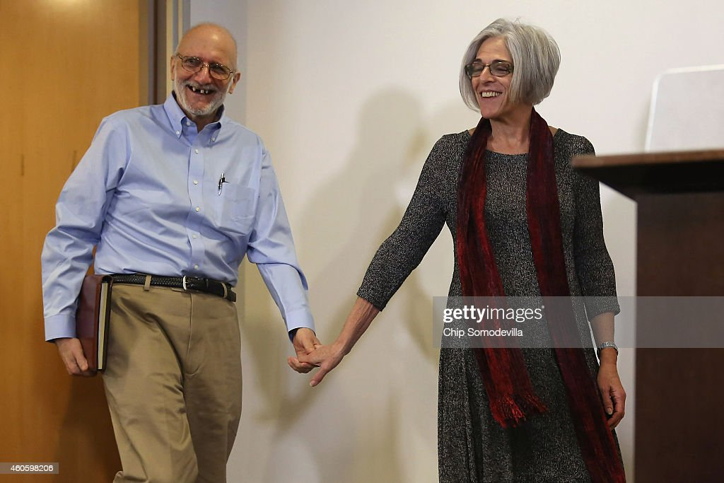 Alan Gross, with his wife Judy, arrive before making a statement to the news media at the law offices of Gilbert LLC after arriving back in the United States December 17, 2014 in Washington, DC. A United States Agency for International Develpment contractor, Gross was imprisoned in Cuba for five years on espionage charges after he delivered satellite telephone equipment to Jews living on the island. Gross' release is signalling a new era in U.S.-Cuba relations as President Barack Obama announced a political thawing between the two countries, the first in more than 50 years.