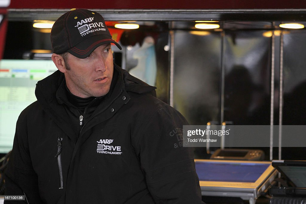 Alan Gustafson, crew chief for Jeff Gordon, driver of the #24 Drive to End Hunger Chevrolet, stands in the garage area during practice for the NASCAR Sprint Cup Series STP 400 at Kansas Speedway on April 20, 2013 in Kansas City, Kansas.