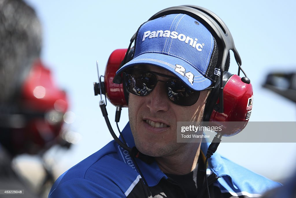 Alan Gustafson crew chief of Jeff Gordon driver of the Panasonic Chevrolet stands on the grid during qualifying for the NASCAR Sprint Cup Series...