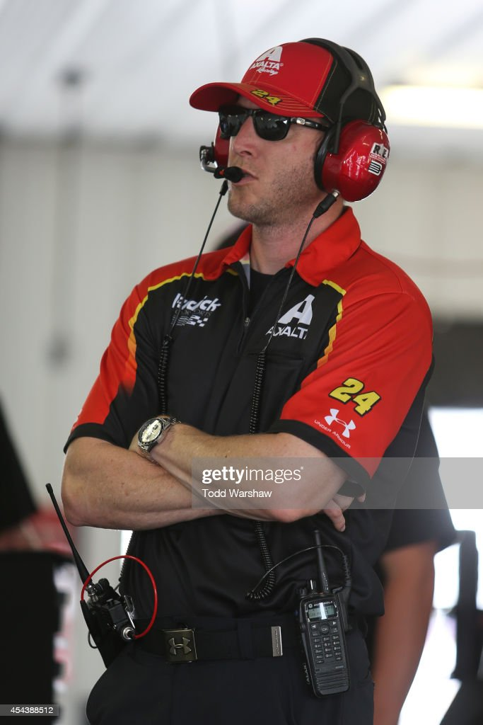 Alan Gustafson crew chief of the Axalta Chevrolet stands in the garage area during practice for the NASCAR Sprint Cup Series GoBowlingcom 400 at...