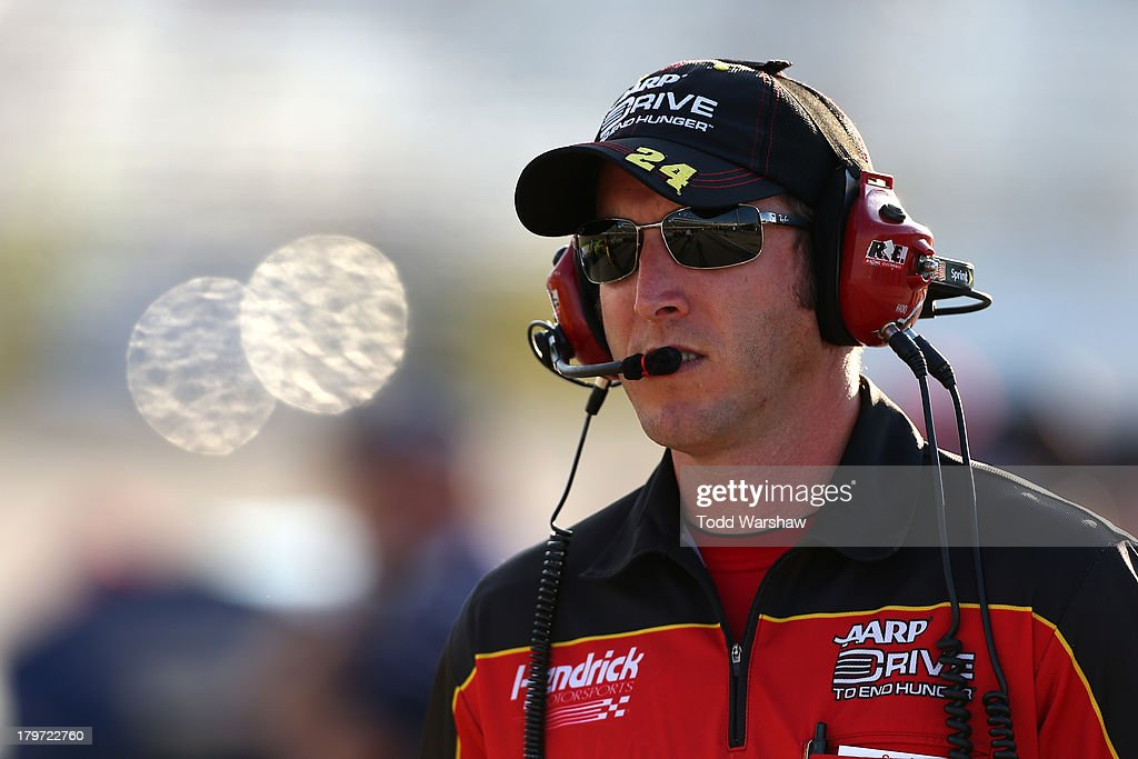 Alan Gustafson crew chief of the Drive to End Hunger Chevrolet looks on from the grid during qualifying for the NASCAR Sprint Cup Series Federated...