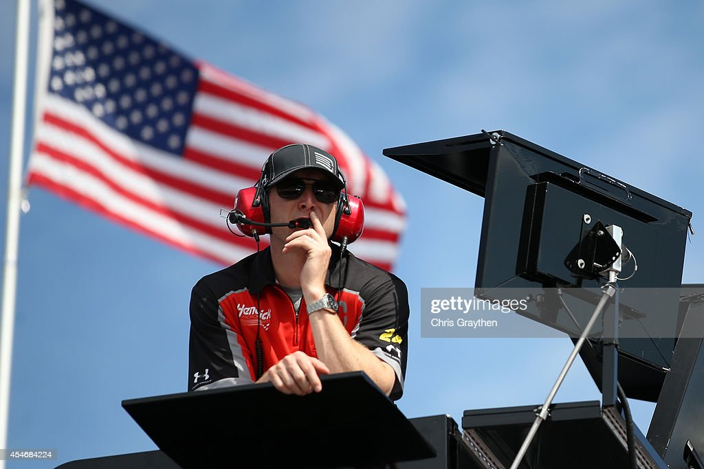 Alan Gustafson crew chief of the Drive to End Hunger Chevrolet looks on from the top of his car transporter during practice for the NASCAR Sprint Cup...