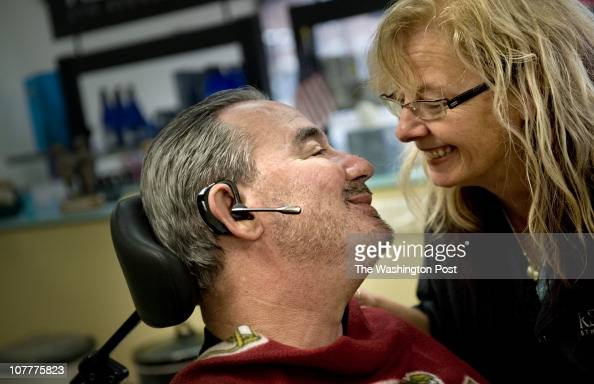 Alan Herman who was diagnosed with ALS two years ago pays a visit to his wife Cathy Herman at her shop Sassy Scissors in Laurel Maryland on Monday...