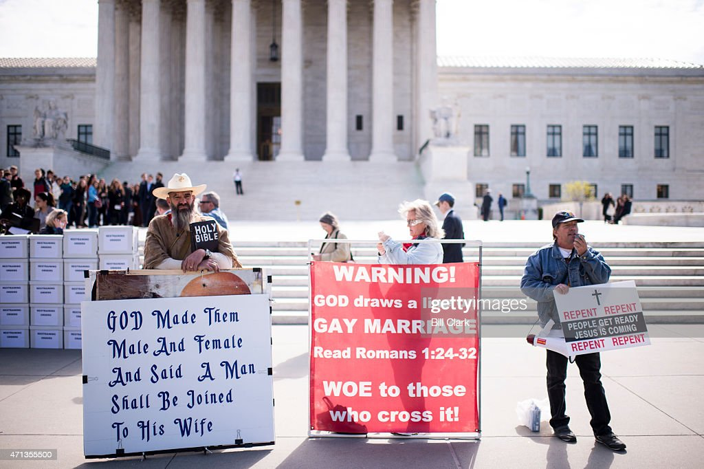 Alan Hoyle of North Carolina left with fellow protesters in front of the US Supreme Court with a bible and several large signs opposing gay marriage...