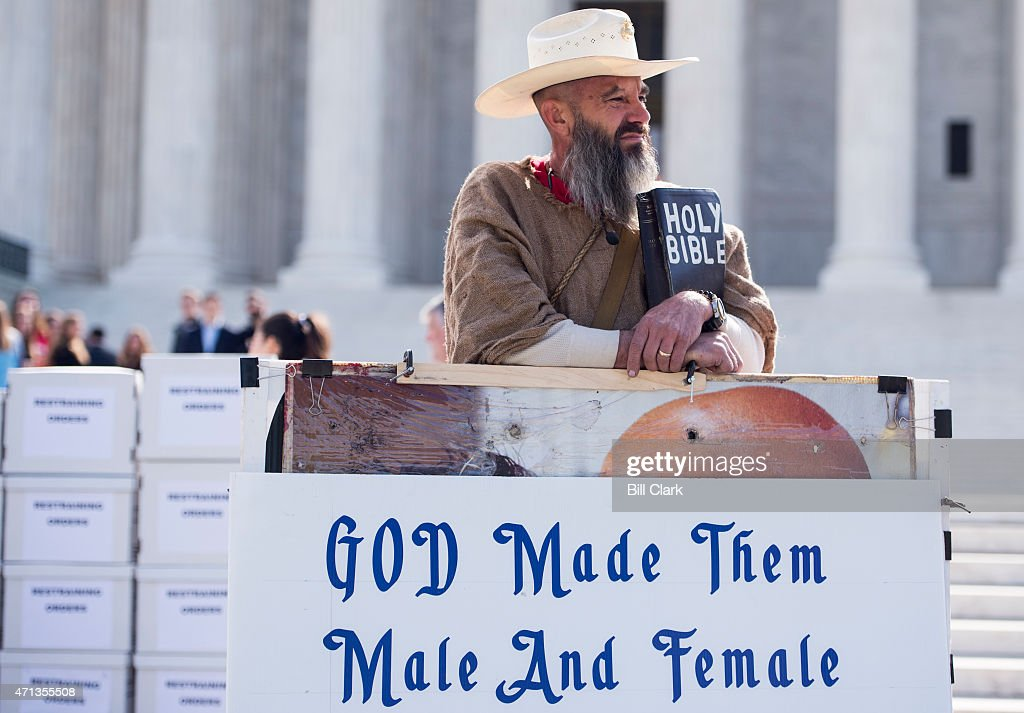 Alan Hoyle of North Carolina stands in front of the US Supreme Court with a bible and several large signs opposing gay marriage on Monday April 27...