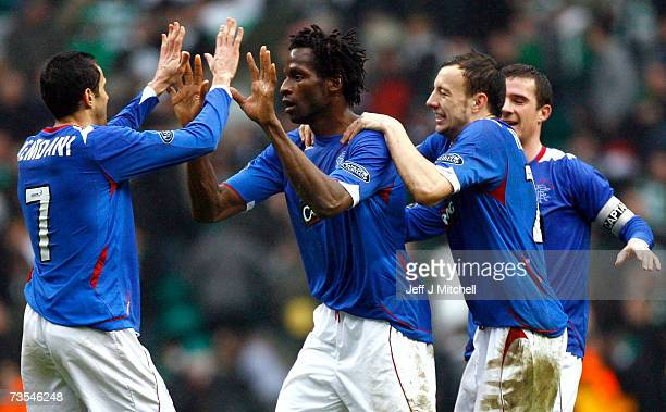 Alan Hutton and Barhim Hemdani congratulate Ugo Ehiogu of Rangers at the end of the Scottish Premier League match between Celtic and Rangers at...