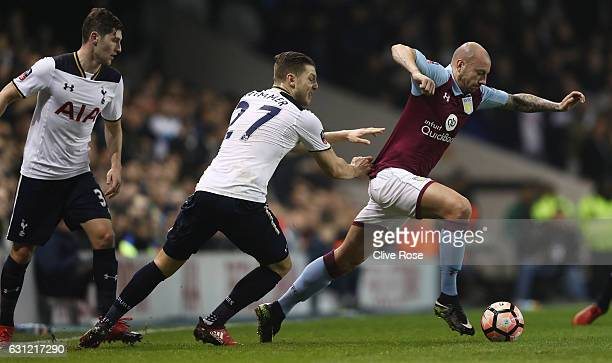 Alan Hutton of Aston Villa attempts to get away from Kevin Wimmer of Tottenham Hotspur during The Emirates FA Cup Third Round match between Tottenham...