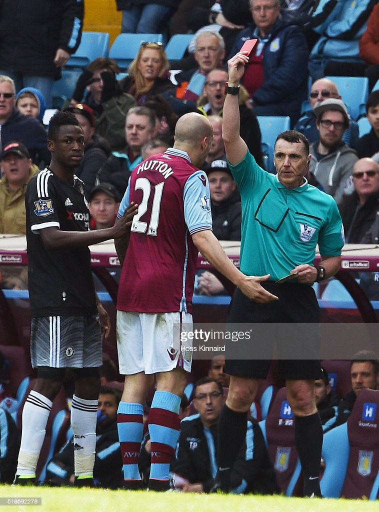 Alan Hutton of Aston Villa is shown a red card by referee Neil Swarbrick during the Barclays Premier League match between Aston Villa and Chelsea at Villa Park on April 2, 2016 in Birmingham, England.