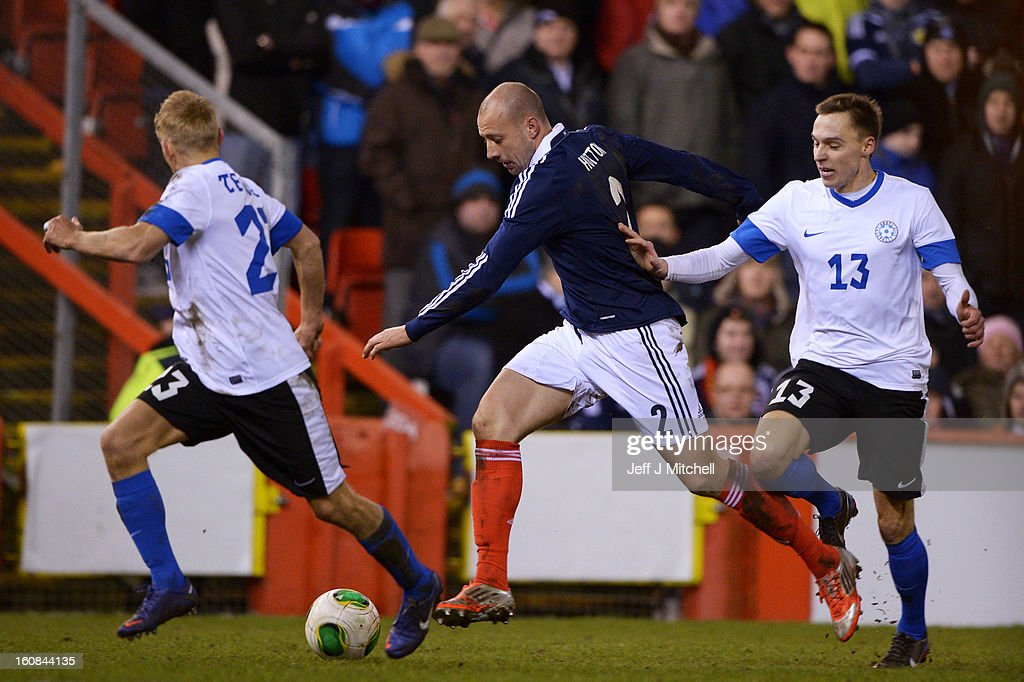 Alan Hutton of Scotland tackles Siim Luts of Estonia during the international friendly match between Scotland and Estonia at Pittodrie Stadium on February 6, 2013 in Aberdeen, Scotland.