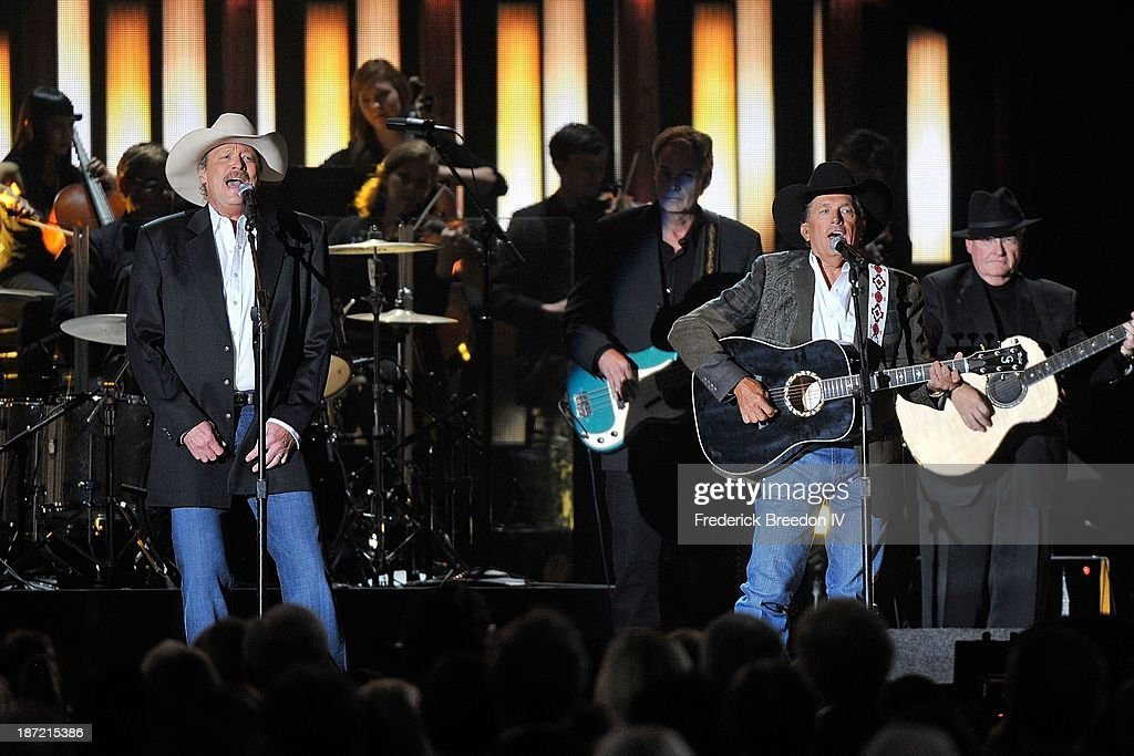 Alan Jackson and George Strait perform a tribute to the late George Jones during the 47th annual CMA awards at the Bridgestone Arena on November 6, 2013 in Nashville, Tennessee.